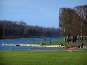 Park of the Palace of Versailles - Grand Canal, lawns and cut trees