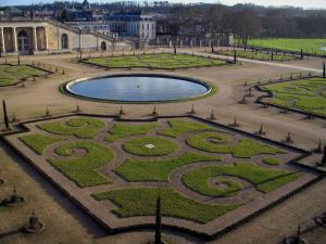 Park of the Palace of Versailles - Orangerie in winter (flowerbeds and lake)