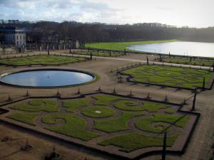 Park of the Palace of Versailles - Orangerie in winter (flowerbeds and lake) and the Suisses ornamental lake