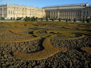 Park of the Palace of Versailles - Midi flowerbed and castle (Midi wing being restored)