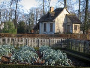 Park of the Palace of Versailles - Queen's hamlet: house with a thatched roof