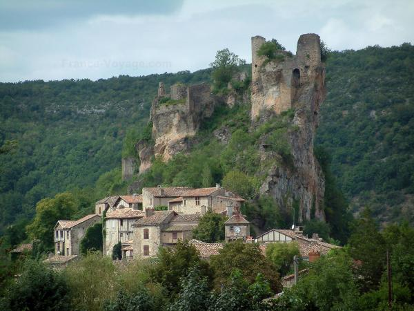 Penne - Ruins of the castle (fortress) perched on a rocky mountain spur and overhanging the houses of the village (Albigensian fortified town), trees and forest