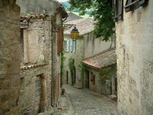 Penne - Narrow paved street in the village (Albigensian fortified town) with its stone houses and its lamppost