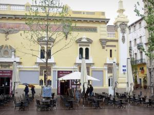 Perpignan - Terrace of a brasserie and Baroque façade of the Victory square