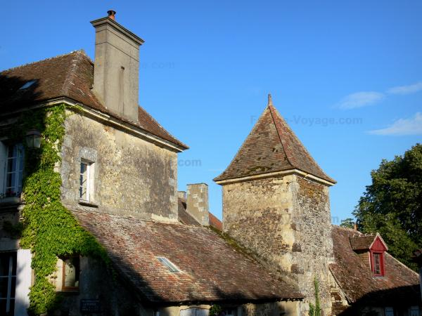 La Perrière - Square tower and houses of the village; in the Perche Regional Nature Park
