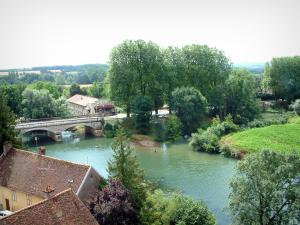 Pesmes - Overview on trees and houses on the edge of the River Ognon, bridge spanning the river (Ognon valley)