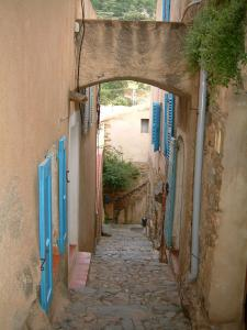 Pigna - Narrow paved street in the village and houses with the blue shutters (in the Balagne region)