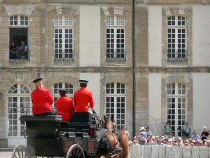 Le Pin national stud farm - Parade of carriages at Jeudis du Pin equestrian show, spectators and facade of the château; in the town of Le Pin-au-Haras