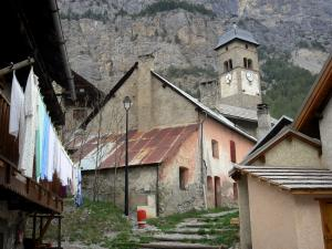 Plampinet - Bell tower of the Saint-Sébastien church and houses of the village; in the Clarée valley
