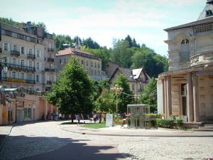 Plombières-les-Bains - Square decorated with trees and flowers,  houses of the hydropathic city (resort)