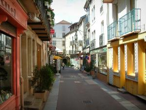 Plombières-les-Bains - Street in the hydropathic city (resort), houses with the forged iron balconies and shops