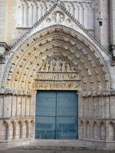 Poitiers - Saint-Pierre cathedral of Gothic style: central portal with carved tympanum