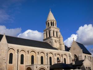 Poitiers - Notre-Dame-la-Grande church of Romanesque style and its bell tower, clouds in the blue sky