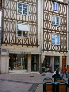 Poitiers - Facades of timber-framed houses, shops and café terrace