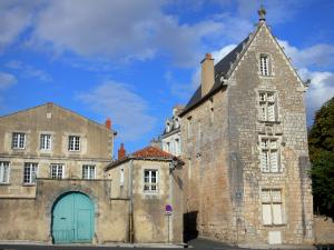 Poitiers - Houses of the Cathedral square, clouds in the blue sky