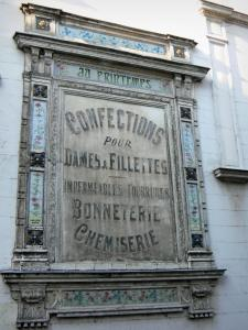 Pont-Audemer - Old advertisements on a facade of the town