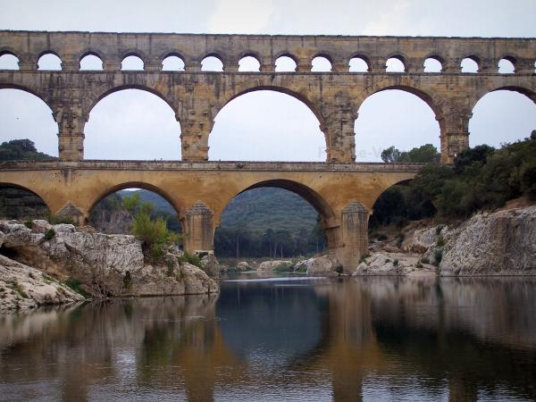 Pont du Gard bridge - Roman aqueduct (ancient monument) with three levels of arcades (arches) spanning the River Gardon; in the town of Vers-Pont-du-Gard