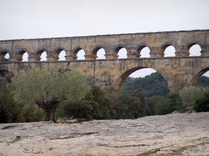 Pont du Gard bridge - Roman aqueduct (ancient monument) and trees; in the town of Vers-Pont-du-Gard