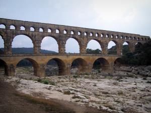 Pont du Gard bridge - Roman aqueduct (ancient monument) with three floors of arcades (arches); in the town of Vers-Pont-du-Gard