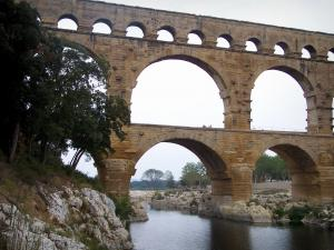 Pont du Gard bridge - Roman aqueduct (ancient monument) with three levels of arches (arches) spanning the River Gardon; in the town of Vers-Pont-du-Gard