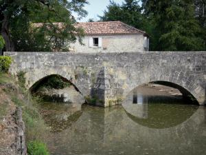 Poudenas - Old bridge spanning River Gélise and old mill in the background; in the Pays d'Albret region