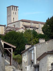 Poudenas - Bell tower of the church overlooking the houses of the village