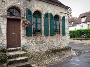 Provins - Stone house with green shutters decorated with flowers