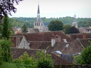 Provins - View of the rooftops of the city, trees, bell tower of the Sainte-Croix church (on the left) and Notre-Dame-du-Val tower (remains of the former Notre-Dame collegiate church)