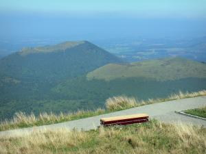 Puy de Dôme volcano - Volcanoes of the Puys mountains (monts Dôme range): footpath with a bench overhanging the surrounding puys; in the Auvergne Volcanic Regional Nature Park