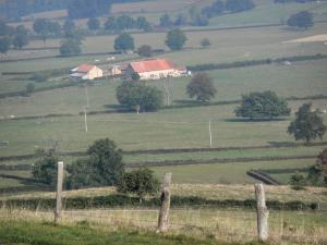 Puy Saint-Ambroise - View of a farmhouse surrounded by fields and pastures