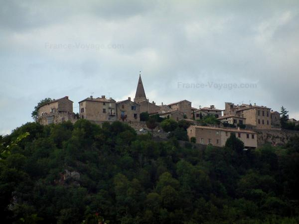Puycelsi - Hilltop village (Albigensian fortified town) overhanging the forest and cloudy sky