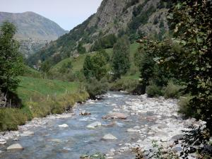 Pyrenees National Park - Stream lined with rocks and trees, mountains overhanging the set