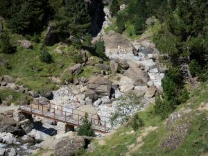 Pyrenees National Park - Footbridge spanning a river, rocks and trees
