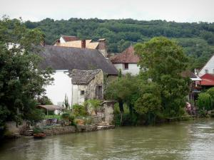 Quingey - Trees and houses of the village along the water (Loue river)
