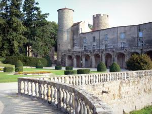 Ravel castle - Tower, keep, arches and facade of the castle, French-style formal garden with cut shrubs and flowerbeds