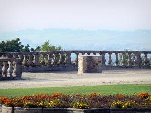 Ravel castle - Garden of the castle with a viewpoint indicator (panorama), flowerbed in the foreground
