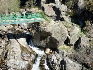 Regional Natural Park of the Ardèche Mountains - Bridge spanning a river with rocks