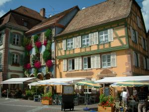 Ribeauvillé - Square with cafe terraces and houses with colourful facades