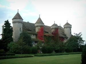 Ripaille castle - Castle with four towers and park with trees, lawns and flowerbeds