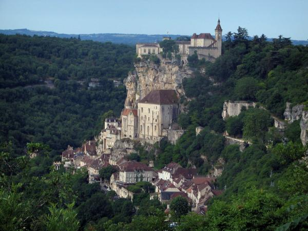 Rocamadour - View of sanctuaries, houses of the village, cliff and castle dominating the set, trees and the forest, in the Regional Nature Park of the Quercy Limestone Plateaus