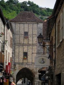 Rocamadour - Stone houses, shop signs of the village and Salmon gateway, in the Regional Nature Park of the Quercy Limestone Plateaus