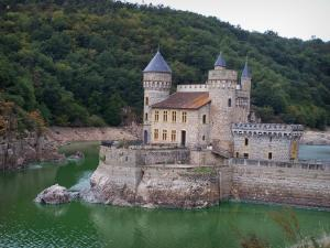 La Roche castle - Château of Gothic style, Loire river and the bank planted with trees; in Saint-Priest-la-Roche