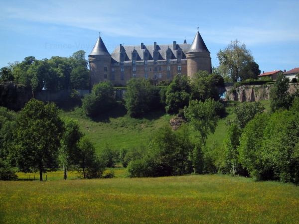 Rochechouart castle - Castle home to the Contemporary Art museum, trees and prairie dotted with wild flowers in the Périgord-Limousin Regional Nature Park