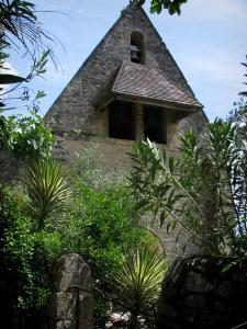 La Roque-Gageac - Church of the village and tropical vegetation, in the Dordogne valley, in Périgord