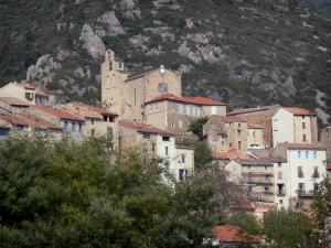 Roquebrun - Church and houses of the village and trees, in the Orb valley, in the Upper Languedoc Regional Nature Park