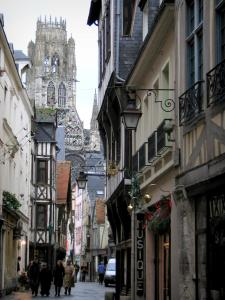 Rouen - Narrow street lined with houses and view of the tower of the Saint-Ouen abbey church
