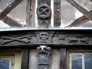 Rouen - Aître Saint-Maclou: macabre details (ornaments) carved on beams and timber framings