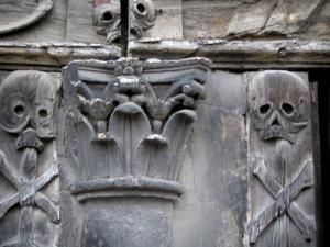 Rouen - Aître Saint-Maclou: macabre details (ornaments) carved on beams