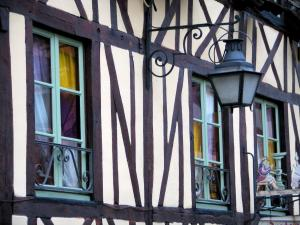 Rouen - Facade of a timber-framed house decorated with a lamppost and shop sign