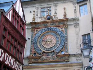 Rouen - Half-timbered house and dial of the Gros-Horloge